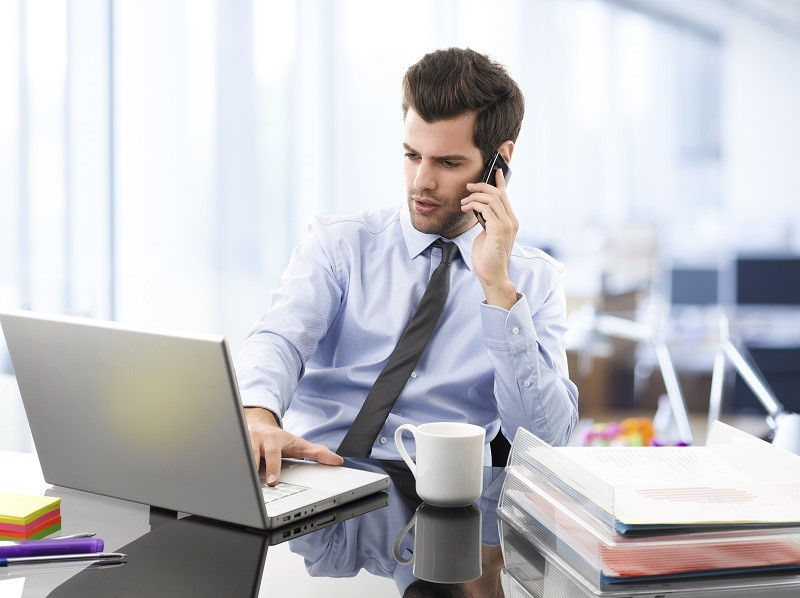 Businessman on phone - message on hold